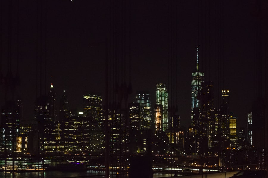views of Manhattan at night from the Manhattan Bridge