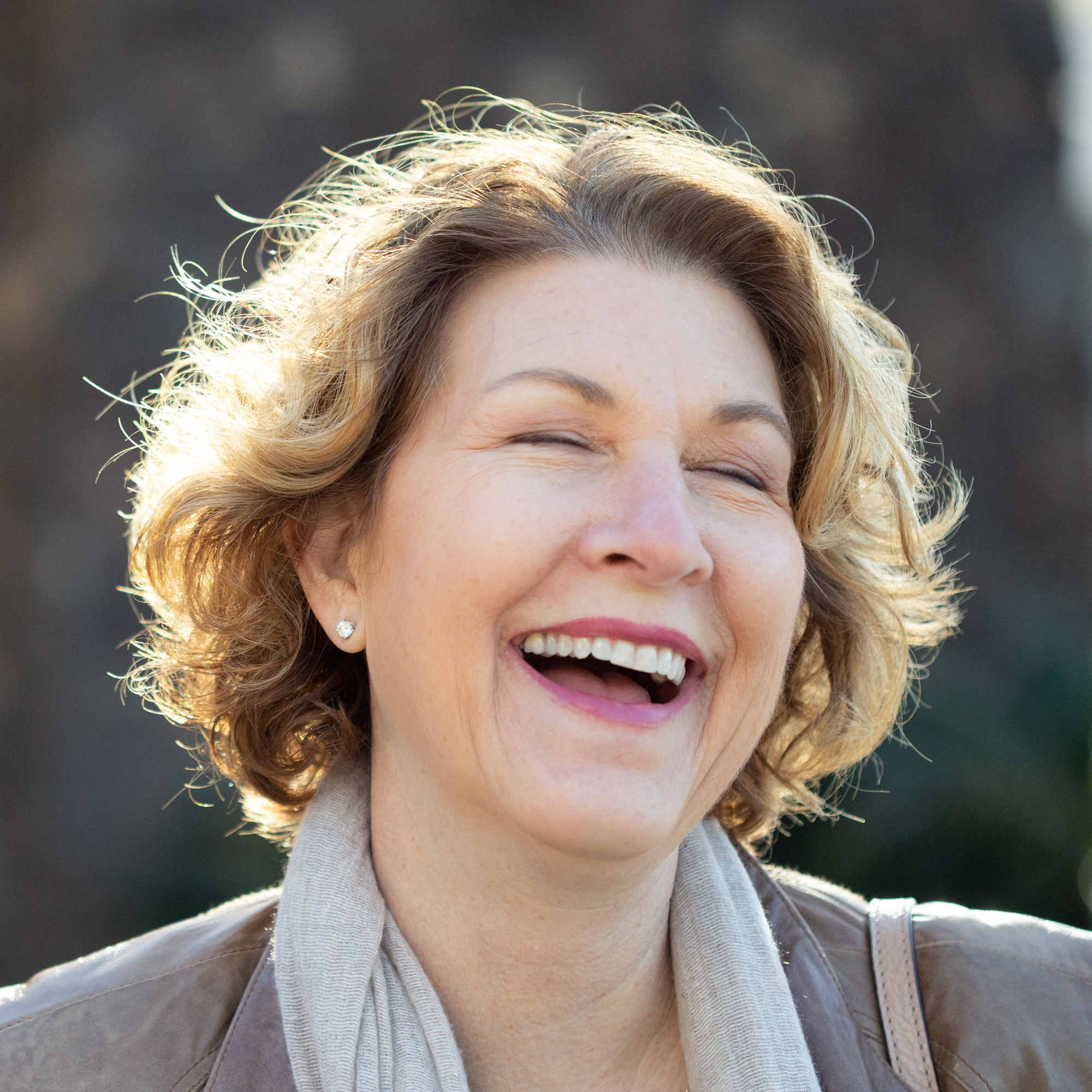 Sharon Eucce laughing during her personal branding shoot in San Diego