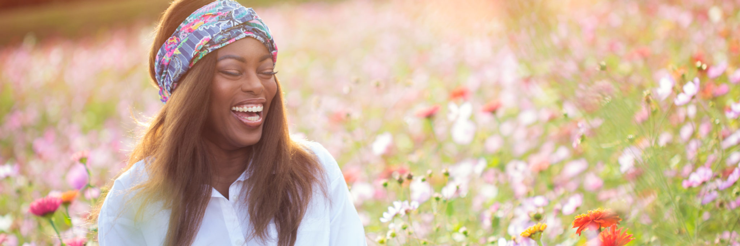 woman laughing in a field for Becca 1916 turban personal branding