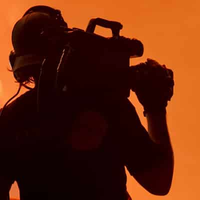 Silhouette of Camera Operator