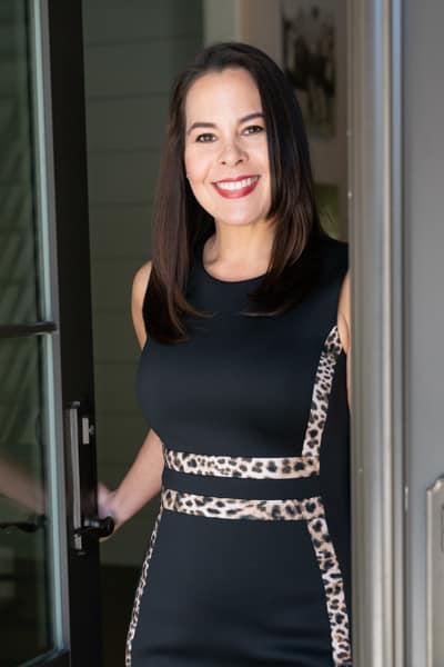 Dawn Levy opening front door of home